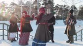 бедный : Russian folk - men and women in traditional Russian clothes are dancing to the accordion n the park