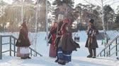 putperest : Russian folk - man and woman in Russian folk costumes are dancing traditional dance