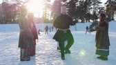 religiöse symbole : Russian folk - man is dancing traditional dance in a circle of women in winter