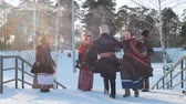putperest : Russian folk - man and woman in Russian folk costumes are dancing traditional dance in sunny weather Stok Video