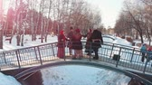 putperest : Russian folklore - people in Russian costumes are dancing on the bridge