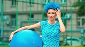 ás : funny girl in a blue dress with a ball