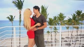 çatı katı : Look at each other, hugging, kissing, on the roof in the caribbean resort Stok Video