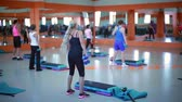 weights : Womens group engaged in aerobics