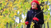 сюрприз : A beautiful woman walks and reflects in the autumn park. teachers day