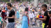 pistole : Xishuangbanna, Yunnan  China - April 15, 2017: People celebrating water splashing festival (Songkran) in southern China