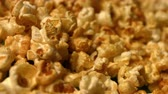 golden : Popcorn on a green background. Slow motion. Close-up. Horizontal pan. 2 Shots Stock Footage