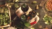 кренделек : Bottles with beer and a snack on the table. Slow motion. Top view. Close-up. The smooth glide of the camera (from left to right) along the table with a bottles of beer and a snacks.