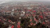 havadan görünüş : Drone tilts from bottom to top over the roofs of the German city of Braunschweig in Lower Saxony.
