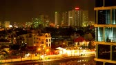 tower : HO CHI MINH CITY, VIETNAM - March 16, 2016: Time-lapse view of traffic and office buildings at night on March 16, 2016 in o Chi Minh City, Vietnam. Stock Footage