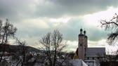 баварский : Time-lapse view of the church in the historic downtown of a small Bavarian town in winter in Wemding, Germany.