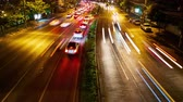 bright night lights : BANGKOK, THAILAND - JANUARY 23: Time-lapse view of the traffic on a highway at night on January 23, 2016 in Bangkok, Thailand.