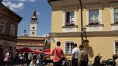 district : ZAGREB, CROATIA - JULY 12: View on people and traffic pass by in the center of the city on July 12, 2017 in Zagreb, Croatia. Stock Footage