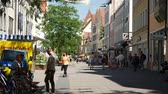 баварский : INGOLSTADT, GERMANY - JUNE 5: View on daily life and historic architecture as People pass by in the center of the city on June 5, 2017 in Ingolstadt, Germany.