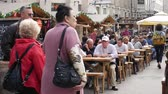 budapeşte : BUDAPEST - OCTOBER 22: View on People and Tourists as they enjoy a street market in the center of the City on October 22, 2017 in Budapest, Hungary. Stok Video