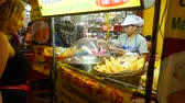 streetfood : BANGKOK - FEBRUARY 20: View on a Street Food vendor and kitchen in the Chinatown neighbourhood of the city on February 20, 2018 in Bangkok, Thailand. Stock Footage