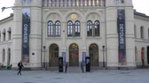 административное здание : OSLO, NORWAY - APRIL 23: View on the historic Institute of Nobel as pedestrians pass by in the center of the city on April 23, 2017 in Oslo, Norway. Стоковые видеозаписи