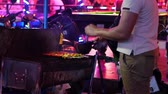 streetfood : PATTAYA, THAILAND - FEBRUARY 23: View on a mobile street kitchen and barbecue at night on February 23, 2018 in Pattaya, Thailand. Stock Footage