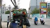 municipal services : PATTAYA, THAILAND - FEBRUARY 23: View on a trash collectors as they work in the city on February 23, 2018 in Pattaya, Thailand.