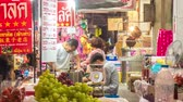 cena urbana : BANGKOK,THAILAND - MARCH 03: Time-lapse view on street food vendors in Chinatown at night on March 03, 2018 in Bangkok,Thailand.
