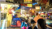 мясо : BANGKOK,THAILAND - MARCH 03: Time-lapse view on a busy street as people and traffic pass by at a street vendor in Chinatown at night on March 03, 2018 in Bangkok,Thailand.