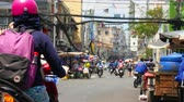 lambreta : HO CHI MINH CITY,VIETNAM - MARCH 08: View on a side street as pedestrians anf traffic pass by on March 08, 2018 in Ho Chi Minh City,Vietnam. Stock Footage