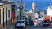 yırtık pırtık : VALPARAISO, CHILE – JUNE 21: View as people pass by in a street on June 21, 2016 in Valparaiso, Chile. Stok Video