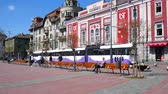 architectural : TIMISOARA, ROMANIA - OCTOBER 15: View on people as they walk and trams as they pass by in the historic centre of the city on October 15, 2017 in Timisoara, Romania. Stock Footage