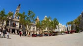 council : VALENCIA, SPAIN – MARCH 15: View on the famous  Plaza Ayuntamiento as people pass by on March 15, 2017 in Valencia, Spain. Stock Footage