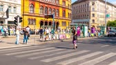 macar : BUDAPEST, HUNGARY – JUNE 24: Timelapse view of the Blaha Lujza square as pedestrians walk through and cars pass by during a busy day on June 24, 2017 in Budapest, Hungary.