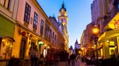 életmód : PECS, HUNGARY - AUGUST 15: Time-lapse view on the historic centre of the city as people pass by at night on August 15, 2018 in Pecs, Hungary Stock mozgókép