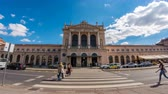 main entrance : ZAGREB, CROATIA - JULY 12: Time-lapse view on traffic and peolpe as they pass by at the entrance of the building of the Zagreb Train Station on July 12, 2017 in Zagreb, Croatia.