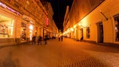 rumunština : TIMISOARA, ROMANIA - OCTOBER 15: Time-lapse view on historical architecture as pedestrians pass by in the centre at dusk on October 15, 2017 in Timisoara, Romania.