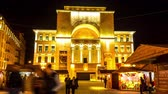 romanian : TIMISOARA, ROMANIA - OCTOBER 15: Time - lapse view on people as they pass by at the historical building of the Romanian National Opera at night on October 15, 2017 in Timisoara, Romania.
