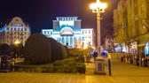 rumunia : TIMISOARA, ROMANIA - OCTOBER 15: Time-lapse view on the historic centre as people pass by at night on October 15, 2017 in Timisoara, Romania.
