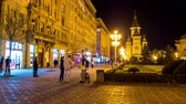 main street : TIMISOARA, ROMANIA - OCTOBER 15: Time-lapse view on the historic centre as people pass by at night on October 15, 2017 in Timisoara, Romania.