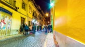 godo : LISBOA, PORTUGAL - JANUAR 12: Time-lapse view of an illuminated street in the famous Bairro Alto district as people pass by at the pubs at night on January 12, 2018 in Lisboa, Portugal. Vídeos