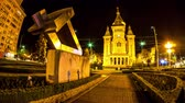 romanya : TIMISOARA, ROMANIA - OCTOBER 15: Time-lapse view on the Timisoara Orthodox Cathedral as traffic passes by at the historical building at night on October 15, 2017 in Timisoara, Romania.