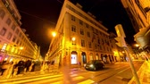 godo : LISBON, PORTUGAL - CIRCA JANUARY 2018: Time-lapse view of the illuminated buildings in the centre of the city as people and traffic pass by at night circa January 2018 in Lisbon, Portugal.