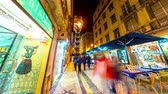 godo : LISBON, PORTUGAL - CIRCA JANUARY 2018: Time-lapse view of illuminated streets in the historic centre of the city as people and traffic pass by at night circa January 2018 in Lisbon, Portugal.