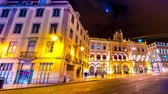 godo : LISBON, PORTUGAL - CIRCA JANUARY 2018: Time - lapse view of the illuminated buildings in the centre of the city as people and traffic pass by at night circa January 2018 in Lisbon, Portugal.