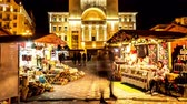 kurum : TIMISOARA, ROMANIA - OCTOBER 15: Time - lapse view on people as they pass by at the traditional market front of historical building of the Romanian National Opera at night on October 15, 2017 in Timisoara, Romania.
