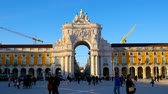 monumentální : LISBON, PORTUGAL - CIRCA JANUARY 2018: View of the iconic City Gate in the historic centre of the city as people and traffic pass by during the day circa January 2018 in Lisbon, Portugal.