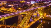 português : Time-lapse view on the illuminated Old Town and the iconic Dom Luis Bridge at the River Douro in Porto during sunset.