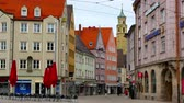 manzara : AUGSBURG, GERMANY - CIRCA APRIL 2017: View on the daily life and the architecture of the historic centre of the city on circa April 2017 in Augsburg, Germany. Stok Video