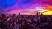 cabaça : Time-lapse view on the skyline of the city as colorful clouds pass by in the light of the setting sun in Buenos Aires, Argentina. Stock Footage