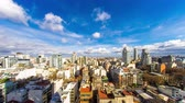 latin amerika : Time-lapse view on the skyline of the city from a balcony of a high rise apartment as Sun breaks through between fast move clouds in Buenos Aires.