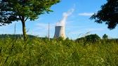 radyasyon : GERMANY - CIRCA JUNE 2017: View on nature with cooling tower of nuclear power plant in the background circa June, 2017 in Germany