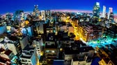 gayrimenkul : Night time-lapse view on the skyline of the city from a balcony of a high rise apartment in Buenos Aires, Argentina. Stok Video