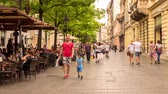 gastos : BELGRADE, SERBIA - CIRCA JUNE 2018: Time-lapse view on people as they walk on the pedestrian zone on a busy street in the downtown of the city circa June 2018 in Belgrade, Serbia.